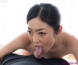 Japanese slut licks a hard dick and gets a load of hot cum on her pink tongue