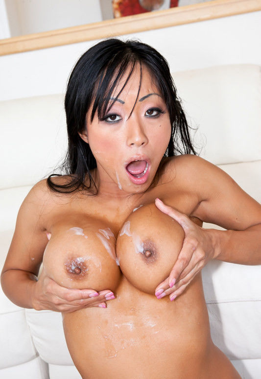 Horny Gaia squeezing her massive cum covered tits