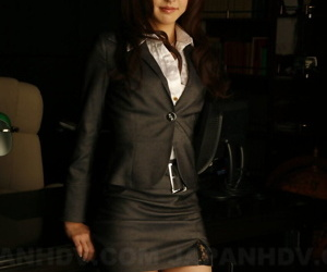 Japanese secretary Julia Nanase shows some leg after exposing her bra