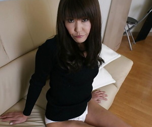 Slippy asian lady Emiko Okajima stripping down and spreading her legs