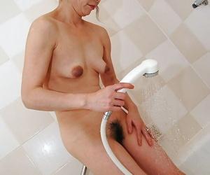 Asian MILF with hairy twat and tiny tits Mayumi Miyazaki taking shower