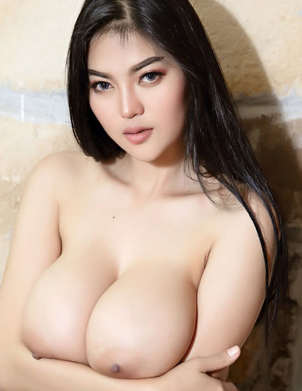 Seductive busty Asian strips naked