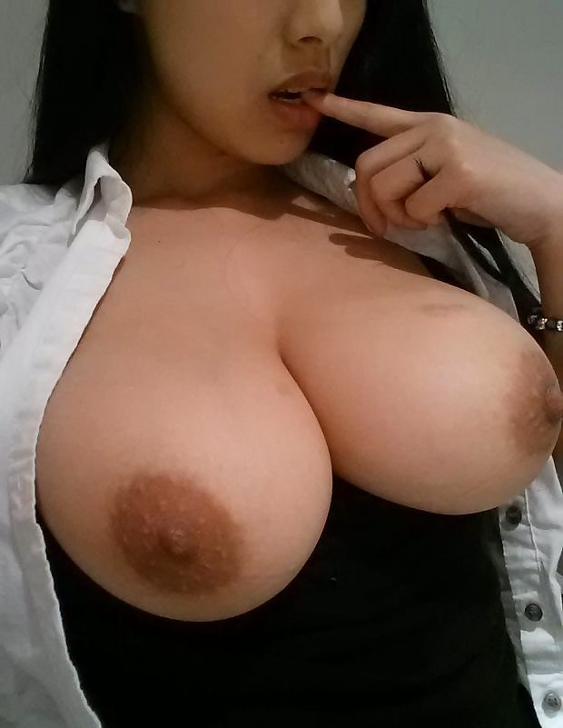 Seductive Filipina With Massive Boobs and Nipples Like Silver Dollars