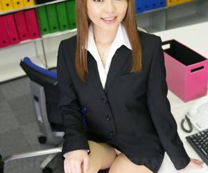 Japanese office worker Saki flashes white underwear at her desk