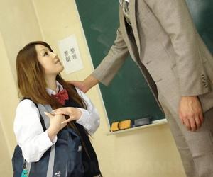 Japanese schoolgirl Ria Sakurai wears cum on face after sex with male teachers