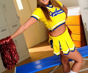 Adorable Japanese cheerleader uncovers great tits before showing her pussy