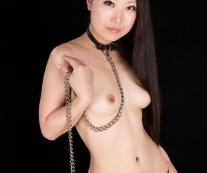 Tied of Japanese hottie is forced to suck cock before being masturbated