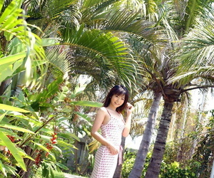 Young looking Japanese girl Saki Ninomiya gets naked with ocean behind her