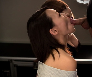 Clothed Japanese girl sucks the sperm out of a small cock during a double BJ