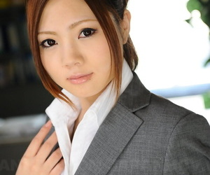 Japanese businesswoman Iroha Kawashima bares her bra before donning glasses