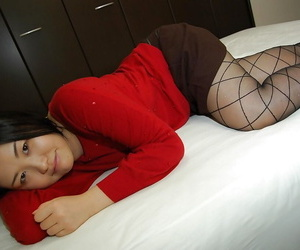 Playful asian girl in pantyhose slowly uncovering her fuckable body