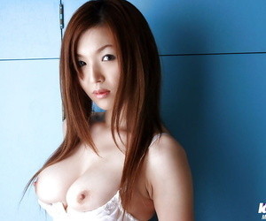Pretty asian chick with petite tits Mai Hanano slipping off her lingerie