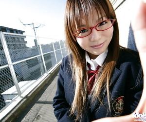 Nasty asian schoolgirl Yume Kimino taking off her skirt and panties