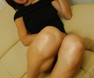 Asian chick Rinko Yoshitake getting naked and exposing her slippy curves