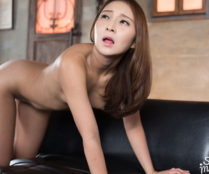 Nude Japanese girl sports a creampie pussy after sexual relations with two men