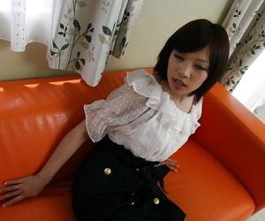 Asian chick Megumi Morishima undressing and spreading her legs
