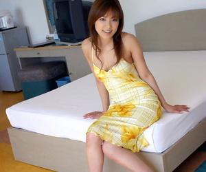 Sweet asian girl Yua Aida taking off her dress and posing in lacy panties
