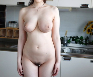 Stunning Japanese wife Rie Tachikawa exposes her big juggs before hard sex