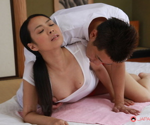 Japanese chick Ichika Aimi is oiled up by masseur before being masturbated