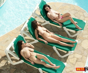 3 big boobed females go topless while soaking up some rays on lounge chairs