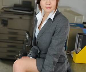 Beautiful Japanese businesswoman Iroha Kawashima exposes her brassiere at work