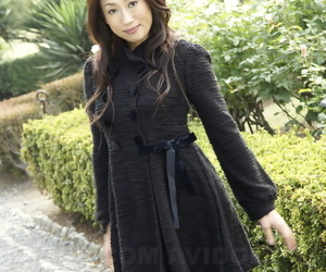 Fully clothed Japanese teen models in the park in black clothes and stockings