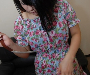 Asian teen Miku Makino striping down and demonstrating her wet pink hole