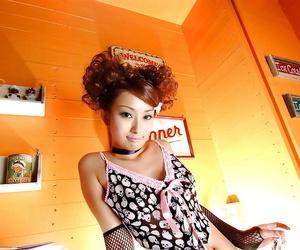 Asian cutie Nao Yoshizaki exposing her sweet tits and hairy cunt