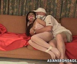 Asian slut is getting roped up..