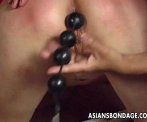 Bound Asian skank on a revolving..