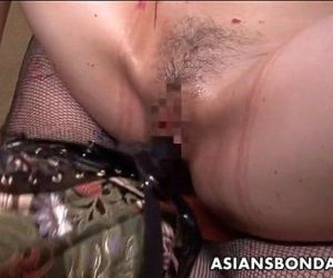Tattooed up Asian domina strap on..