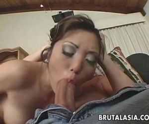 Asian cock gobbler sucking on a..