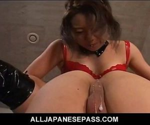 Horny Japanese MiLF in red latex..