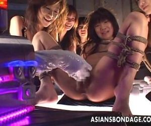 Tied up Asian babe gets fucked..