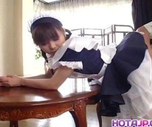 Pretty Asian maid Natsumi exposes..
