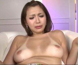 Mai Kuroki sucks a cock while her..