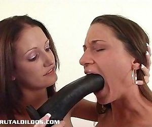 Hailey fucking Alissa with a big black brutal dildo