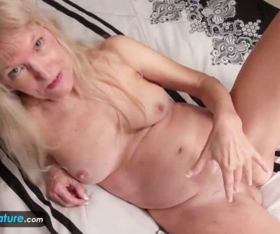 Old granny blonde small tits showing nipples masturbating hairy pussy