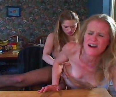 Two Lesbians. Mature And Young Who Use Strap.