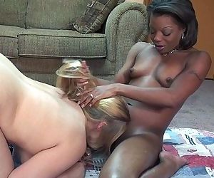 Gorgeous interracial lesbians with strapon fucking each otherHD