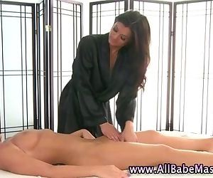 Hot lesbo masseuse licks babe