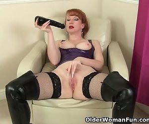 British milf Red fucks a big..