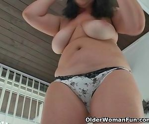 Curvy milf Ria Black strips off..
