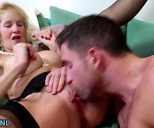 Big boobed blonde mature bouncing..