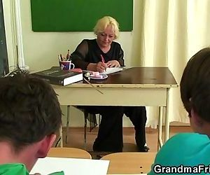 Mature teacher is fucked by two..