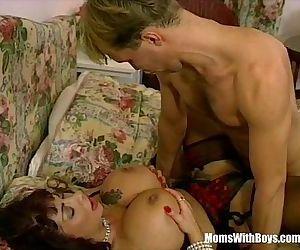 MILF Brunette With Massive Tits..