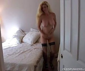 Big tits blonde MILF in stockings..