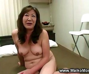 Horny japanese milf gets fingered..