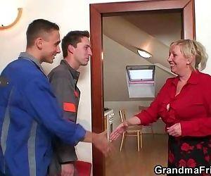 Old widow pleases two repair men..