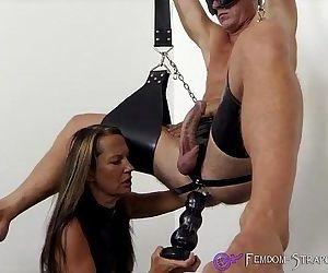 Femdom fucks slave with dildos..
